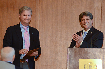 Chancellor Holden Thorp accepts the Dean's Award